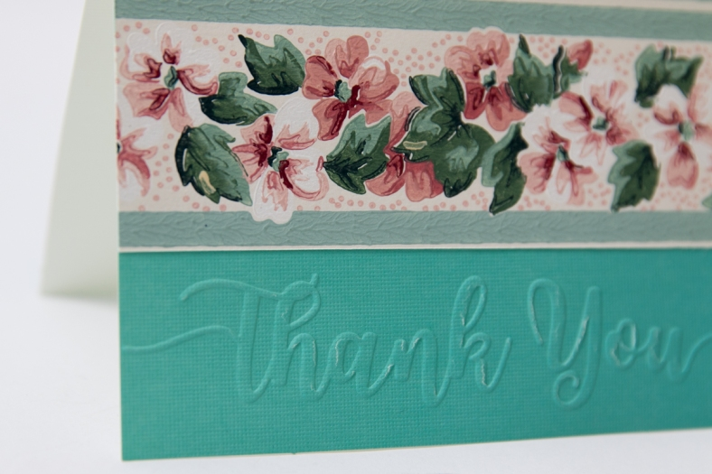 turquoise card with flower wallpaper and embossed Thank you